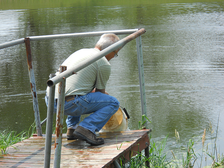 Kurt stocking the pond central wisconsin fur fin and for Stocked fishing ponds